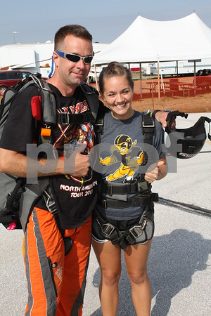 Sky Diver Greg Nore and Nicole Prelip thumbs up and ready