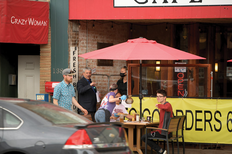 Matthew Gaston   The Sheridan Press<br>Mayor Roger Miller speaks with Severine Murdoch, owner of the Cowboy Cafe, about the freedom rally taking place two doors down at Smith Alley Brewing Company Friday, May 15, 2020. For Murdoch, complying with the city variances demonstrates the Cowboy Cafe's staff's concern for the well being of their customers.