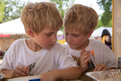 Identical twins Alex and Max (age 7) from Alexandria VA examine fossils at the University of Montana booth.