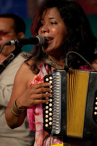 Lidia María Hernández López of La India Canela representing the Dominican Republic, a renowned female accordionist of merengue típico