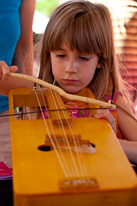 trying a hand at the CRWTH, traditional Welsh musical instrument