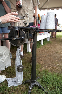 The hand operated sock weaving machine.
