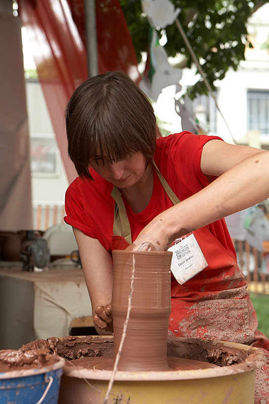 Caitlin Jenkins, an 8th generation artisan. The stick helps her make each piece the same height.