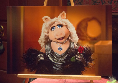 """Photo of Miss Piggy wearing the real """"Hope Diamond"""" from the Smithsonian collection."""