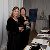 Christine McEntyre and Cacye Kovacs of Diamond Doxen Rescue browse the silent auction items at the Snow Ball Gala.