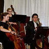 Schreiner University music students entertain guests with a classical ensemble of music at the Snow Ball Gala.