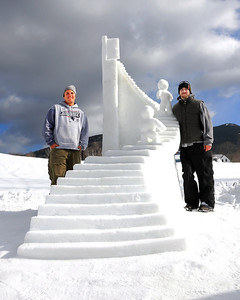 "Greg Grady Jr. & Jason Williams, of Derry, NH, stand by their newly carved ""Knockin' On Heaven's Door"" sculpture, their entry in the annual New Hampshire Sanctioned Jackson Snow Sculpting Invitational, at Black Mountain Ski Area, in Jackson, NH, on January 29th, 2012."