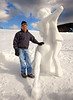 "Dick Devellian, of Jackson, NH, stands with his snow sculpture, ""No Room For The Holy Ghost"", which features a close dancing couple, at the annual New Hampshire Sanctioned Jackson Snow Sculpting Invitational, on January 29th, 2012, at Black Mountain Ski Area, in Jackson, NH."
