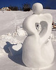 This snow sculpture, created by Team Skorstad, of Vermont, casts a heart-shaped shadow, at the 11th Annual New Hampshire Sanctioned Jackson Snow Sculpting Invitational, at Black Mountain Ski Area, in Jackson, NH, on January 29th, 2012.