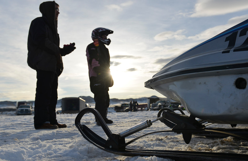 Justin Sheely | The Sheridan Press<br /> Drivers and their friends test and tune their machines during the snowmobile racing event at Sheridan Speedway Saturday, Jan. 27, 2018. This was the first time Sheridan hosted the Extreme Mountain Racing circuit.