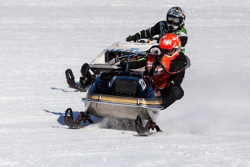 Tibby McDowell | The Sheridan Press<br /> <br /> Jake Kekich counterbalances his sled with his weight around the curve during the X-Treme Mountain Racing snommobile races at Sheridan Speedway Saturday Jan. 27, 2018.