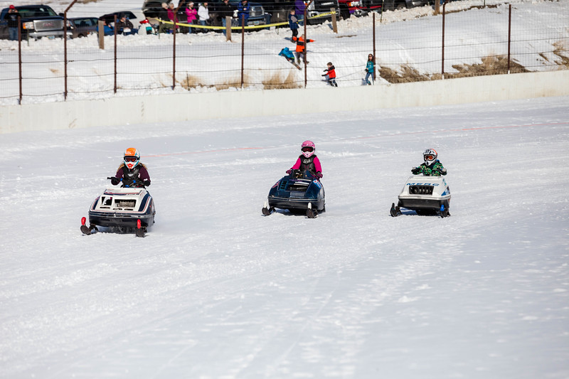 Tibby McDowell | The Sheridan Press<br /> <br /> Colette Kronfuss, Averil Kronfuss, and Otis Leniger approach the starting line during the X-Treme Mountain Racing snommobile races at Sheridan Speedway Saturday Jan. 27, 2018.
