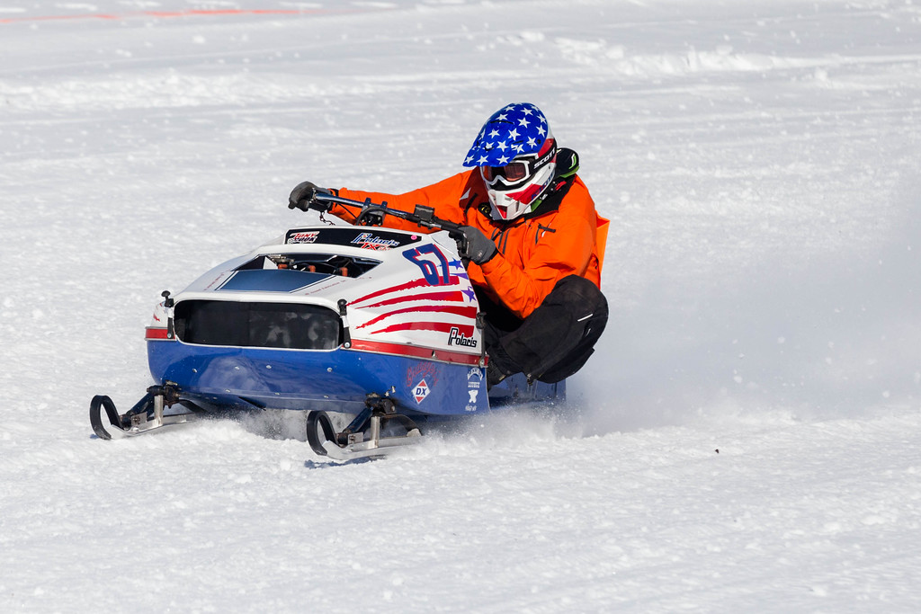 Tibby McDowell | The Sheridan Press<br /> <br /> Dean Charpentier counterbalances his sled with his weight around the curve during the X-Treme Mountain Racing snommobile races at Sheridan Speedway Saturday Jan. 27, 2018.