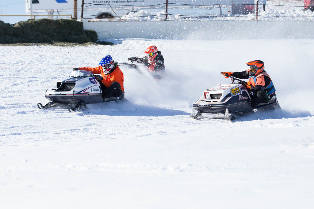 Tibby McDowell | The Sheridan Press<br /> <br /> Dean Charpentier takes the lead out of turn one during the X-Treme Mountain Racing snommobile races at Sheridan Speedway Saturday Jan. 27, 2018.
