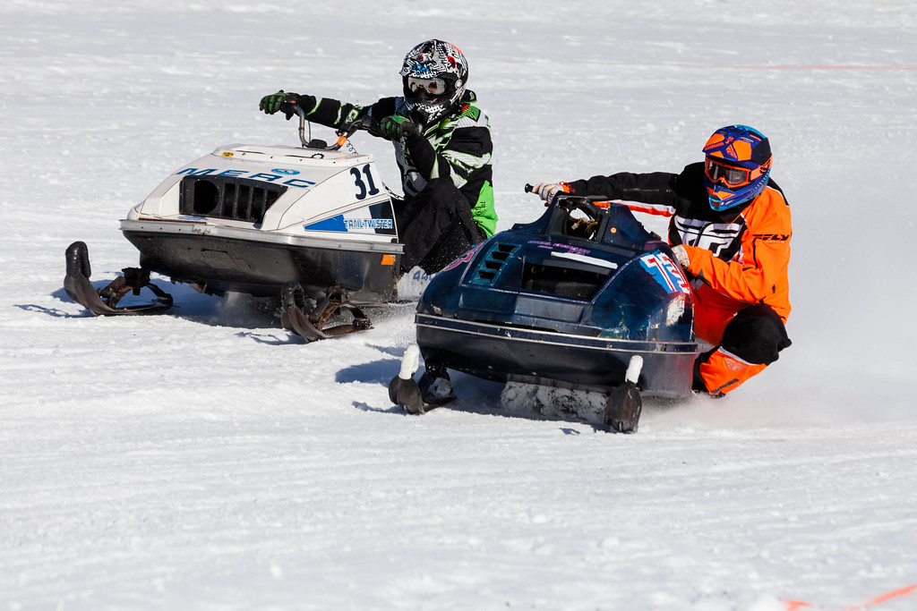 Tibby McDowell | The Sheridan Press<br /> <br /> Dave Leniger, left, and Kevin Kronfuss, right, round the corner  during the X-Treme Mountain Racing snommobile races at Sheridan Speedway Saturday Jan. 27, 2018.