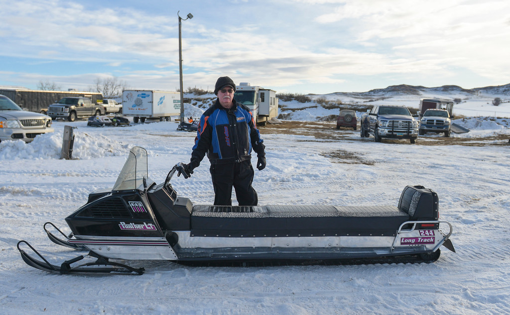 Justin Sheely | The Sheridan Press<br /> Tom Chapman of Gillette stands behind his long track at the staging area during the snowmobile racing event at Sheridan Speedway Saturday, Jan. 27, 2018. This was the first time Sheridan hosted the Extreme Mountain Racing circuit.
