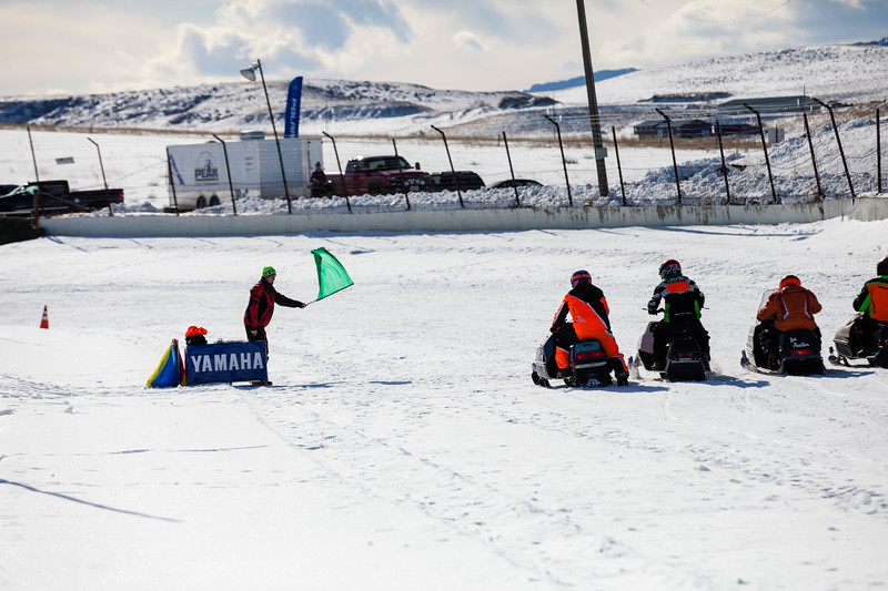 Tibby McDowell | The Sheridan Press<br /> <br /> The green flag drops for racers during the X-Treme Mountain Racing snommobile races at Sheridan Speedway Saturday Jan. 27, 2018.