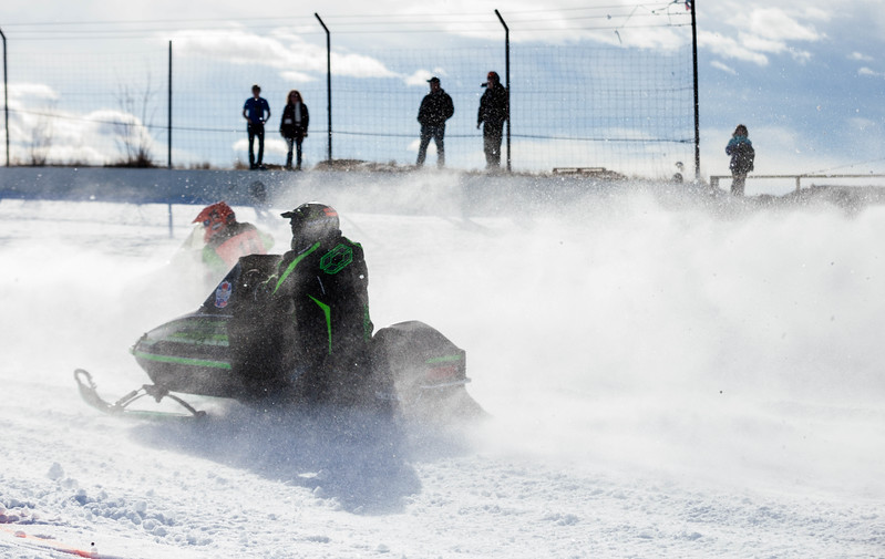 Tibby McDowell | The Sheridan Press<br /> <br /> Spectators lined the fences around the track during the first appearance in Sheridan of the X-Treme Mountain Racing snommobile races at Sheridan Speedway Saturday Jan. 27, 2018.