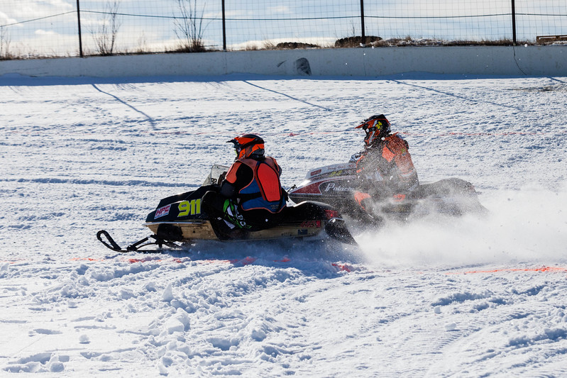 Tibby McDowell | The Sheridan Press<br /> <br /> Racers kick up snow and turn a tight corner during the X-Treme Mountain Racing snommobile races at Sheridan Speedway Saturday Jan. 27, 2018.