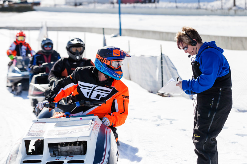 Tibby McDowell | The Sheridan Press<br /> <br /> Desirae Harmon, right, checks off drivers after the race during the X-Treme Mountain Racing snommobile races at Sheridan Speedway Saturday Jan. 27, 2018.