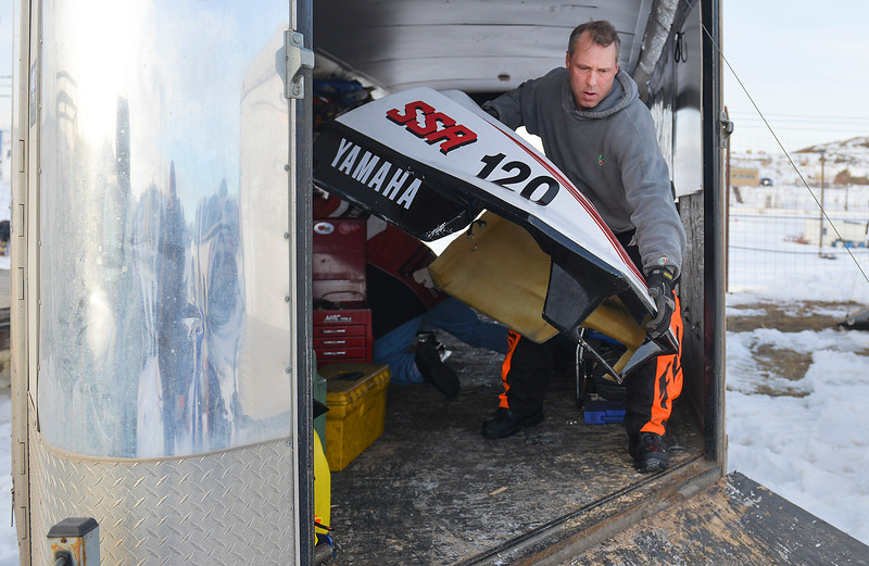 Justin Sheely | The Sheridan Press<br /> Brad Townsend removes the cover to his modified sled during the snowmobile racing event at Sheridan Speedway Saturday, Jan. 27, 2018. This was the first time Sheridan hosted the Extreme Mountain Racing circuit.