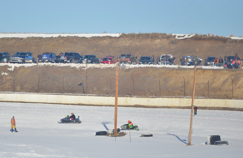 Justin Sheely | The Sheridan Press<br /> Drivers do hot laps on the track during the snowmobile racing event at Sheridan Speedway Saturday, Jan. 27, 2018. This was the first time Sheridan hosted the Extreme Mountain Racing circuit.