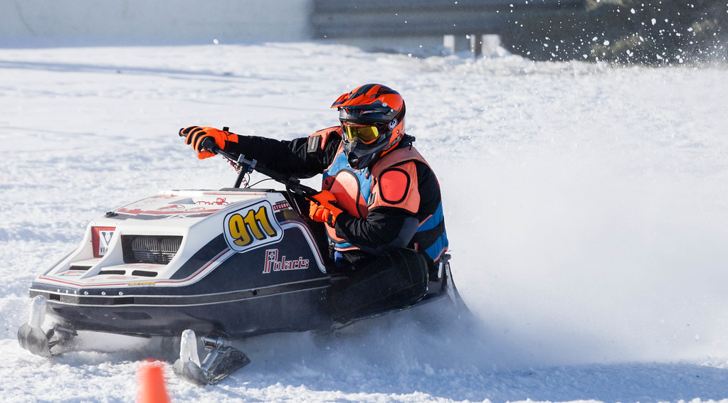 Tibby McDowell | The Sheridan Press<br /> <br /> Dave Chambers kicks up snow around the first turn during the X-Treme Mountain Racing snommobile races at Sheridan Speedway Saturday Jan. 27, 2018.