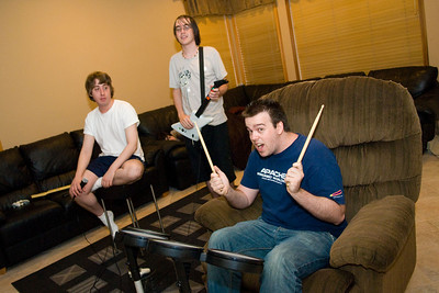 Daniel, Martyn, and Patrick playing Rock Band.