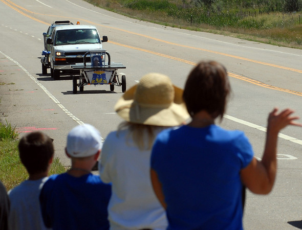 """Fans of the Byron Nelson Bobcats out of Texas, greet their team arriving in Boulder.<br /> High school students from across the U.S. built and drove solar powered cars  900 miles from Ft. Worth, TX, to Boulder. The eight day trip ended on Sunday July 25, 2010.<br />  For more photos and a video of the finish, go to  <a href=""""http://www.dailycamera.com"""">http://www.dailycamera.com</a>.<br />  Cliff Grassmick / July 25, 2010"""