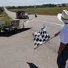 "Dr. Lehman Marks, of the Hunt-Winston School, gives the checkered flag to the Houston (MS) High School  boy's team as they finish.<br /> High school students from across the U.S. built and drove solar powered cars  900 miles from Ft. Worth, TX, to Boulder. The eight day trip ended on Sunday July 25, 2010.<br />  For more photos and a video of the finish, go to  <a href=""http://www.dailycamera.com"">http://www.dailycamera.com</a>.<br />  Cliff Grassmick / July 25, 2010"