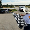 "Dr. Lehman Marks, of the Hunt-Winston School, gives the checkered flag to the South Plantation (FL) High School team as they finish.<br /> High school students from across the U.S. built and drove solar powered cars  900 miles from Ft. Worth, TX, to Boulder. The eight day trip ended on Sunday July 25, 2010.<br />  For more photos and a video of the finish, go to  <a href=""http://www.dailycamera.com"">http://www.dailycamera.com</a>.<br />  Cliff Grassmick / July 25, 2010"