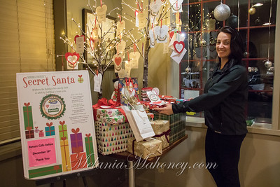 6:21am  Tia Larson arranging the Secret Santa gift table at Park Point