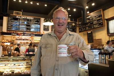 9:55am  Will Ackley and his morning java at Basque Boulangerie.
