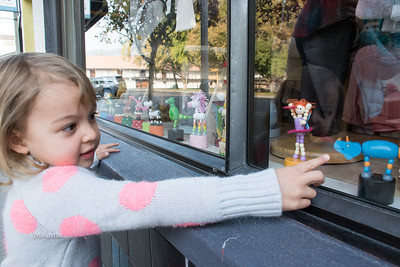 10:06am  Mina Pope-Townsend choosing her favorite toy in the Half-Pint window display.