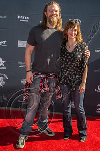 HOLLYWOOD, CA - AUGUST 26:  Actors Ryan Hurst (L) and Maggie Siff attend the 2nd Annual Boot Ride and Rally at The Happy Ending Bar & Restaurant on August 26, 2012 in Hollywood, California.  (Photo by Chelsea Lauren/WireImage)