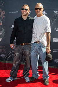 HOLLYWOOD, CA - AUGUST 26:  Actors Charlie Hunnam (L) and David Labrava attend the 2nd Annual Boot Ride and Rally at The Happy Ending Bar & Restaurant on August 26, 2012 in Hollywood, California.  (Photo by Chelsea Lauren/WireImage)