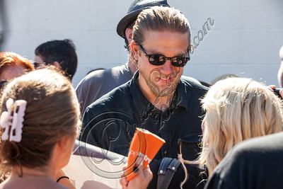 HOLLYWOOD, CA - AUGUST 26:  Actor Charlie Hunnam greets fans at the 2nd Annual Boot Ride and Rally at The Happy Ending Bar & Restaurant on August 26, 2012 in Hollywood, California.  (Photo by Chelsea Lauren/WireImage)