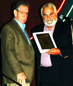 Debbie Blank | The Herald-Tribune Ed Krause (left), Batesville, accepts his plaque from friend and musical partner Deno Koumoutsos.
