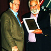 Debbie Blank | The Herald-Tribune<br /> Ed Krause (left), Batesville, accepts his plaque from friend and musical partner Deno Koumoutsos.