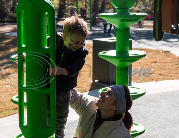 Two-year-old Hank Hampton looks at his mother, Adrienne Hampton, from the top of a green climbing pole during the grand opening of Southside Park playground, an inclusive park where children of all abilities can play, Saturday, Nov. 16, 2019, in Tyler. (Cara Campbell/Tyler Morning Telegraph)
