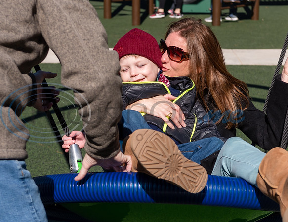 Renae Bryans swings back and forth with her son Jack, 6, on a giant swing as her husband, Casey Bryans, pushes them during the grand opening of Southside Park playground, an inclusive park where children of all abilities can play, Saturday, Nov. 16, 2019, in Tyler. (Cara Campbell/Tyler Morning Telegraph)