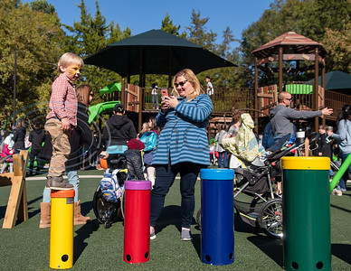 Three-year-old Malakai Deptula jumps across the rainbow samba drums as his mother, Anastasia Deptula, looks on during the grand opening of Southside Park playground, an inclusive park where children of all abilities can play, Saturday, Nov. 16, 2019, in Tyler. (Cara Campbell/Tyler Morning Telegraph)