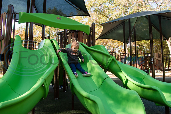 Two-year-old Madelyn Juarez smiles as she make her way down a slide during the grand opening of Southside Park playground, an inclusive park where children of all abilities can play, Saturday, Nov. 16, 2019, in Tyler. (Cara Campbell/Tyler Morning Telegraph)