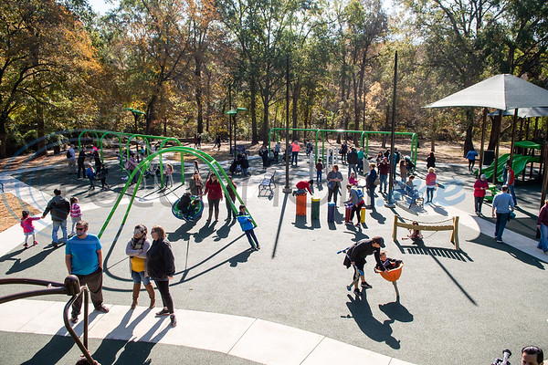 Families laugh and play together during the grand opening of Southside Park playground, an inclusive park where children of all abilities can play, Saturday, Nov. 16, 2019, in Tyler. (Cara Campbell/Tyler Morning Telegraph)