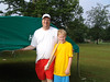 John Hagin and his son offer assistance in putting up a tent.
