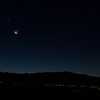 View of Mercury (lower left), Venus (upper left), and the moon above Sandia Mountains and Albuquerque from Corrales, NM