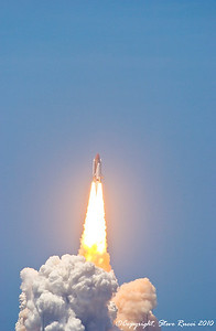 Space Shuttle Atlantis begins roll after liftoff.