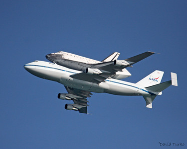 Space Shuttle Discovery ~ Piggy Back on a Boeing 747 flying over Cocoa Beach Florida