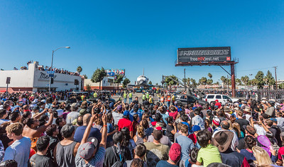 Folks gather to photograph the Space Shuttle Endeavour as it maneuvers to make its last turn on a public road as it prepared to head north on Bill Robertson lane from MLK headed for the California Museum of Science and Industry.