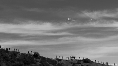 Probably my favorite photo from the series with the crowd watching as the space shuttle flies away.
